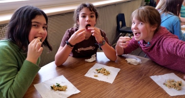 Happy students enjoying stinging nettle pasta. Seconds please!